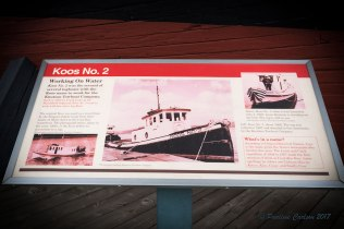 Photo of an educational sign about the Koos No 2 tugboat