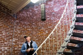 A photo of the tour guide standing on the stairs of the Umpqua Lighthouse