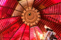 A photo of the brilliant red prisms of the Umpqua Lighthouse seen from inside