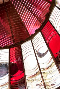 A photo displaying the red and white prisms of the Umpqua Lighthouse that allow it to flash its unique sigma out to sea.