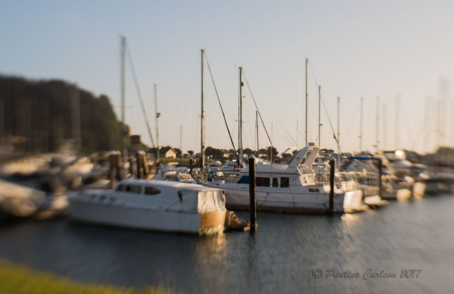 Sunset photo of sailboats on Winchester Bay, Oregon using a Lensbaby