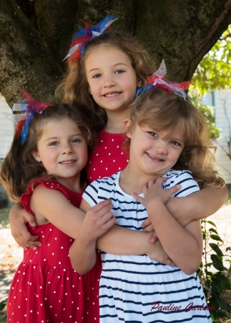 Photo of three girls in front of a tree