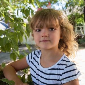 Photo of girl near a tree