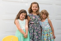 Photo of three girls in dresses
