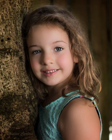 Photo of girl in front of tree
