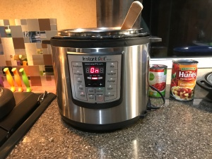 Photo of Instant Pot, an electronic pressure cooker.