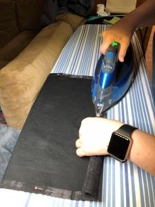 Photo of pressing and pinning seams of drawstring backpack.