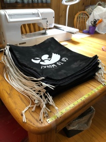 Photo of finished Hawkeye drawstring bags.