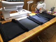 Photo of drawstring bags ready for logos and cords.