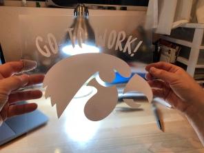 Photo of Gymhawks vinyl logo ready to iron onto fabric.