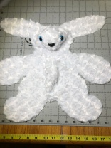 Photo of rabbit front sewn together.