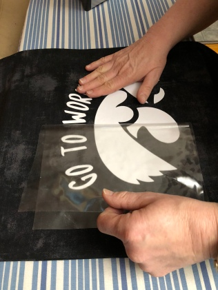 Photo of vinyl polyester backing being removed.