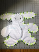Photo of front and back rabbit pieces read to to sew together.