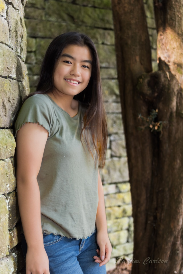 Photo of girl by brick wall at Lewis and Clark College