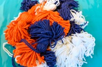 Pauline's Photography Orange, blue, and white tassels
