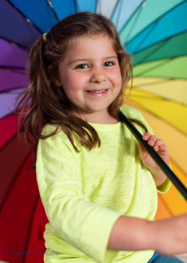Pauline's Photography portrait of little girl and rainbow umbrella